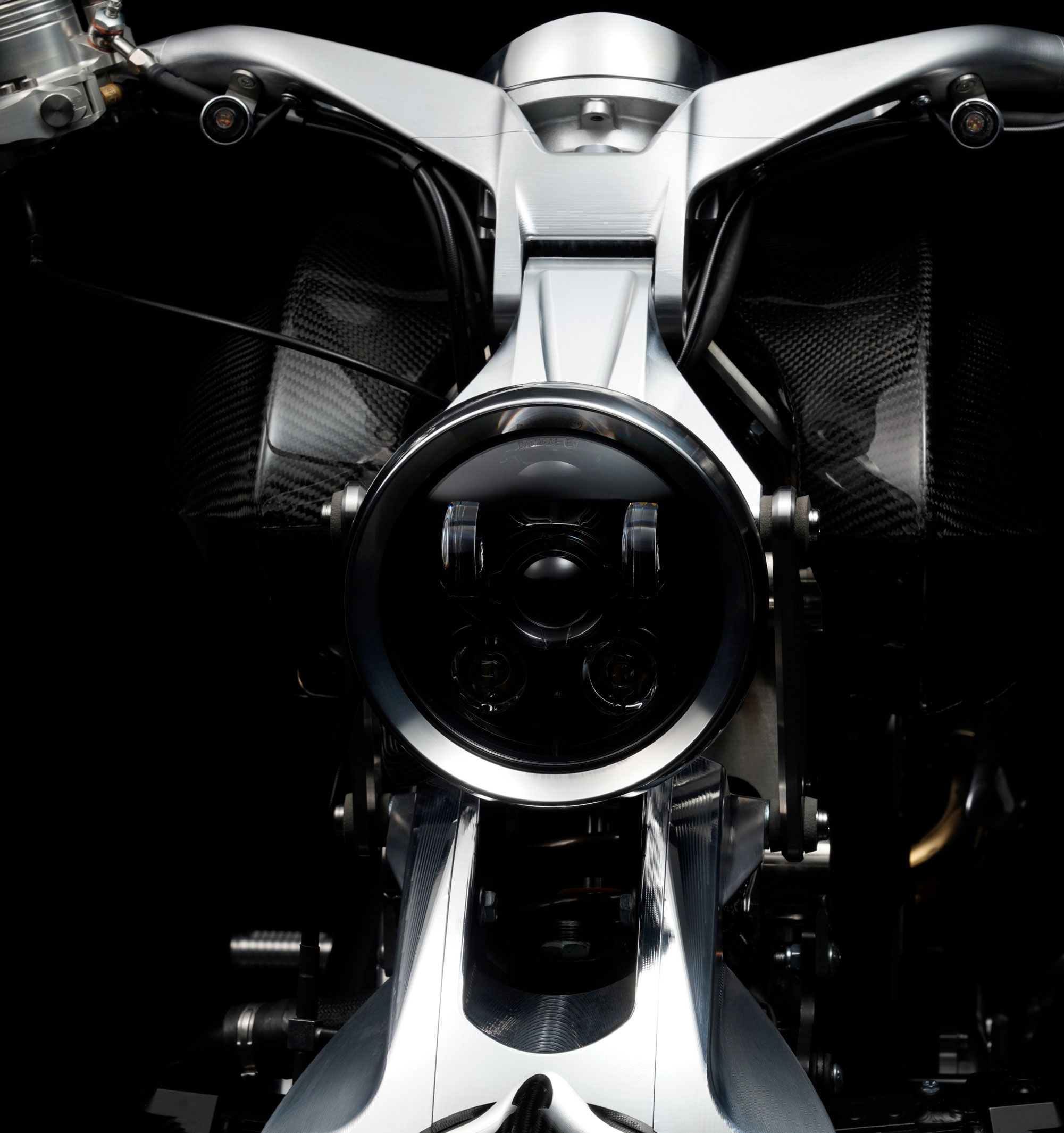 Aluminum components and details bring weight down to a superlight 440 pounds. The look is definitely futuristic from this angle.