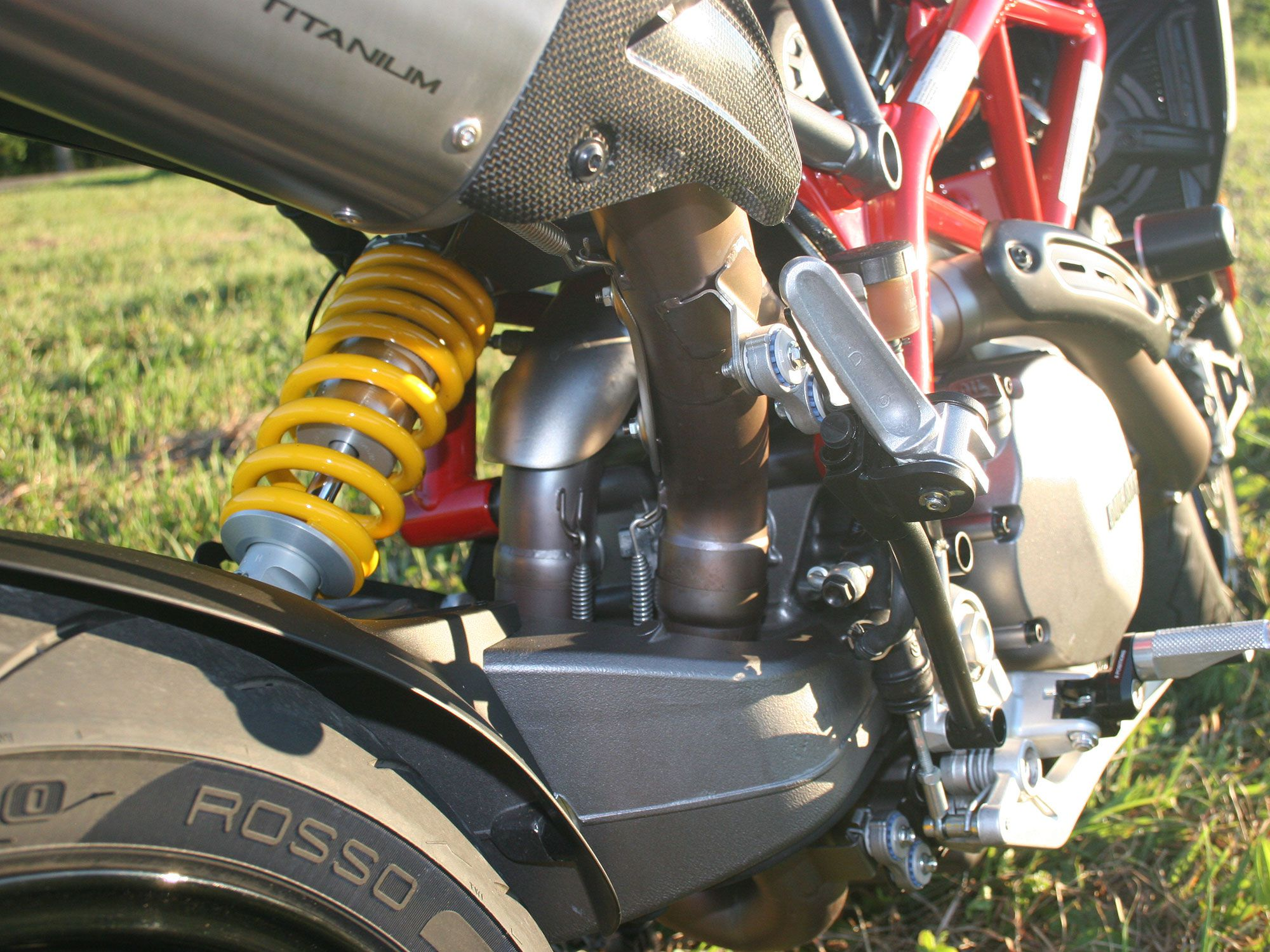 New exhaust routing exposes the swingarm.