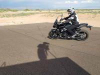 chris peris rides motorcycle at riding school