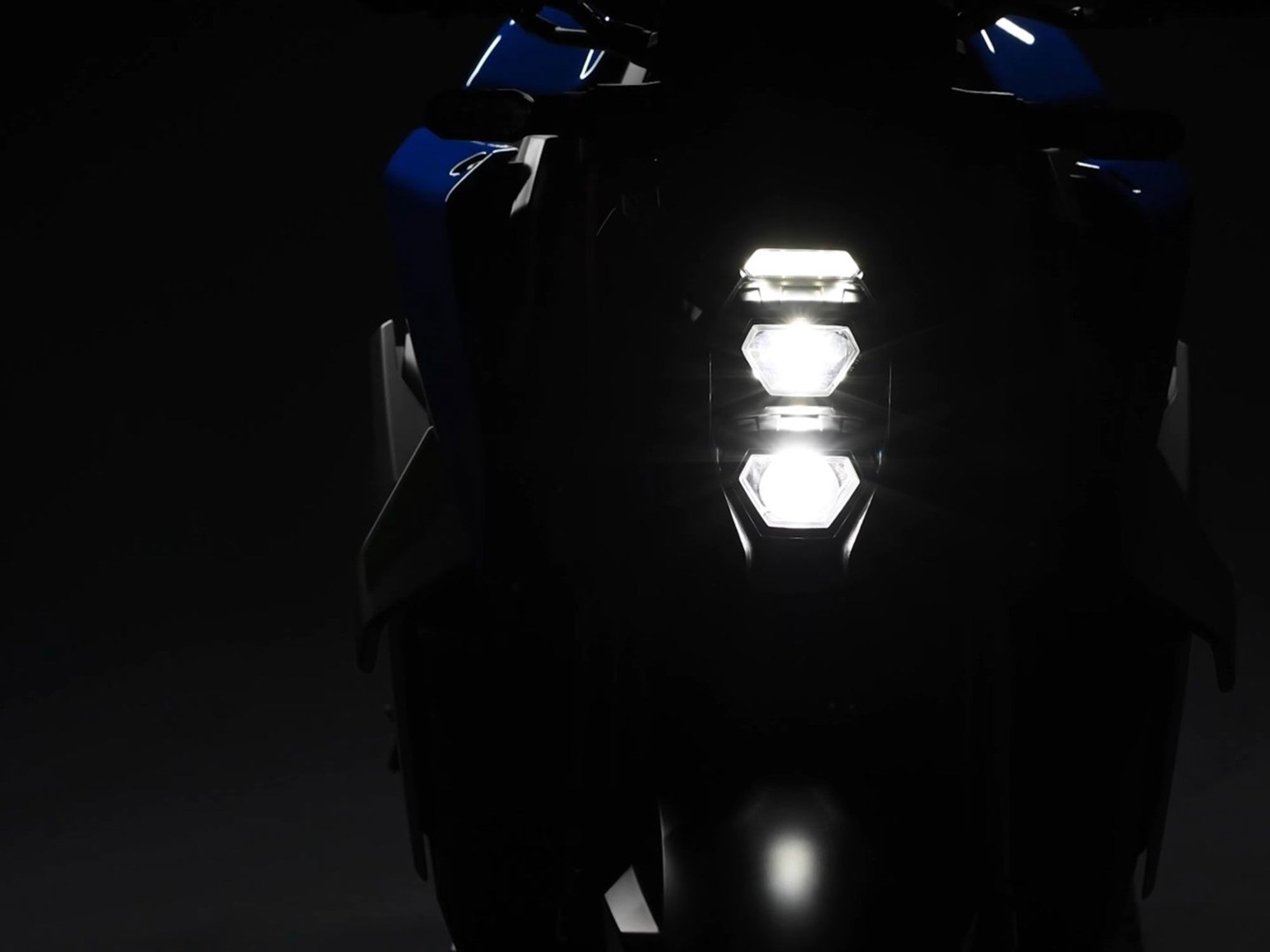 Suzuki's new teaser for its upcoming GSX-S1000 model reveals more modern, triple stacked LEDs leading the way.