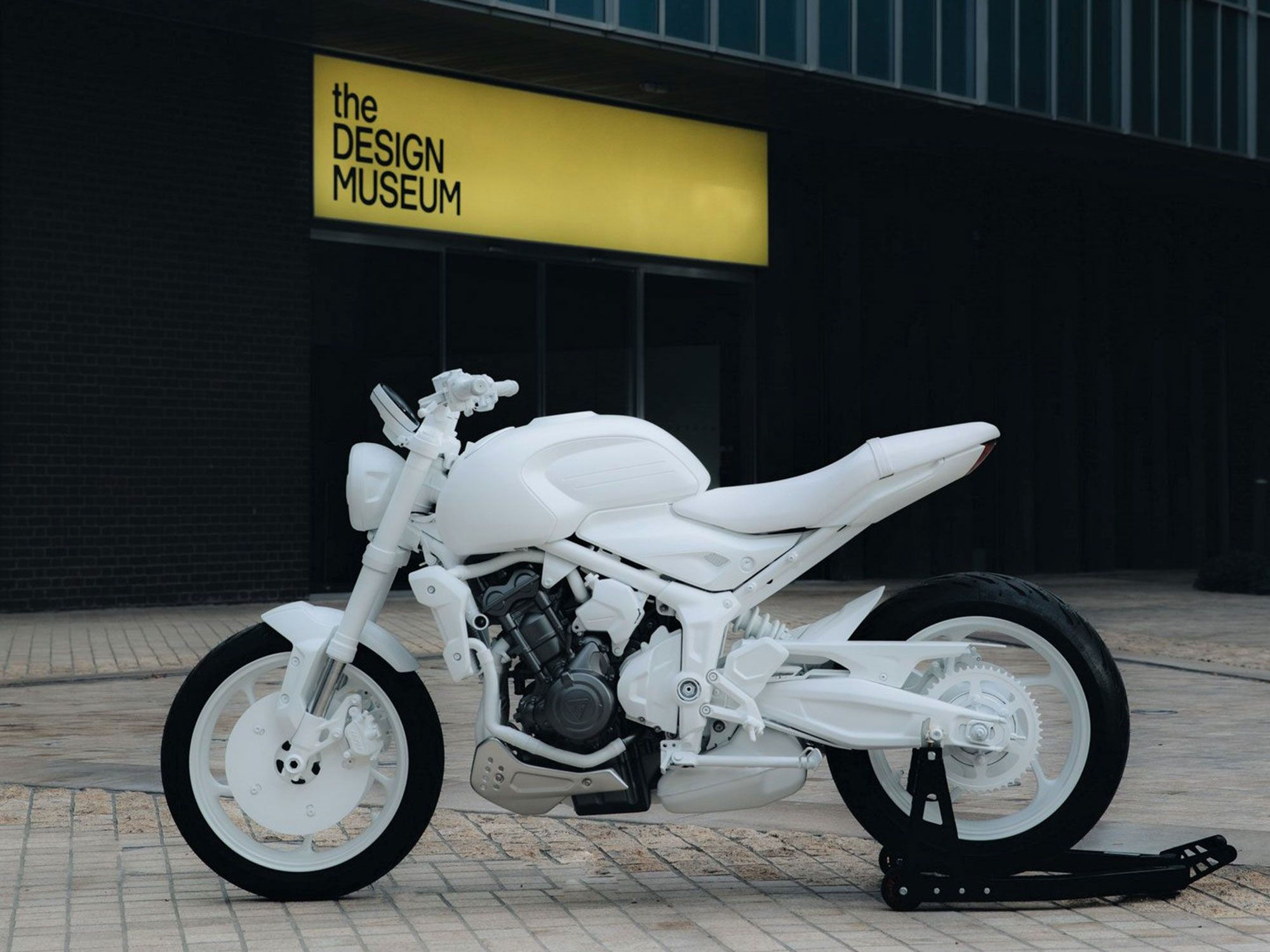 """It may look bleached out, but under that white paint, Triumph's new middleweight Trident """"prototype"""" seems production-ready."""