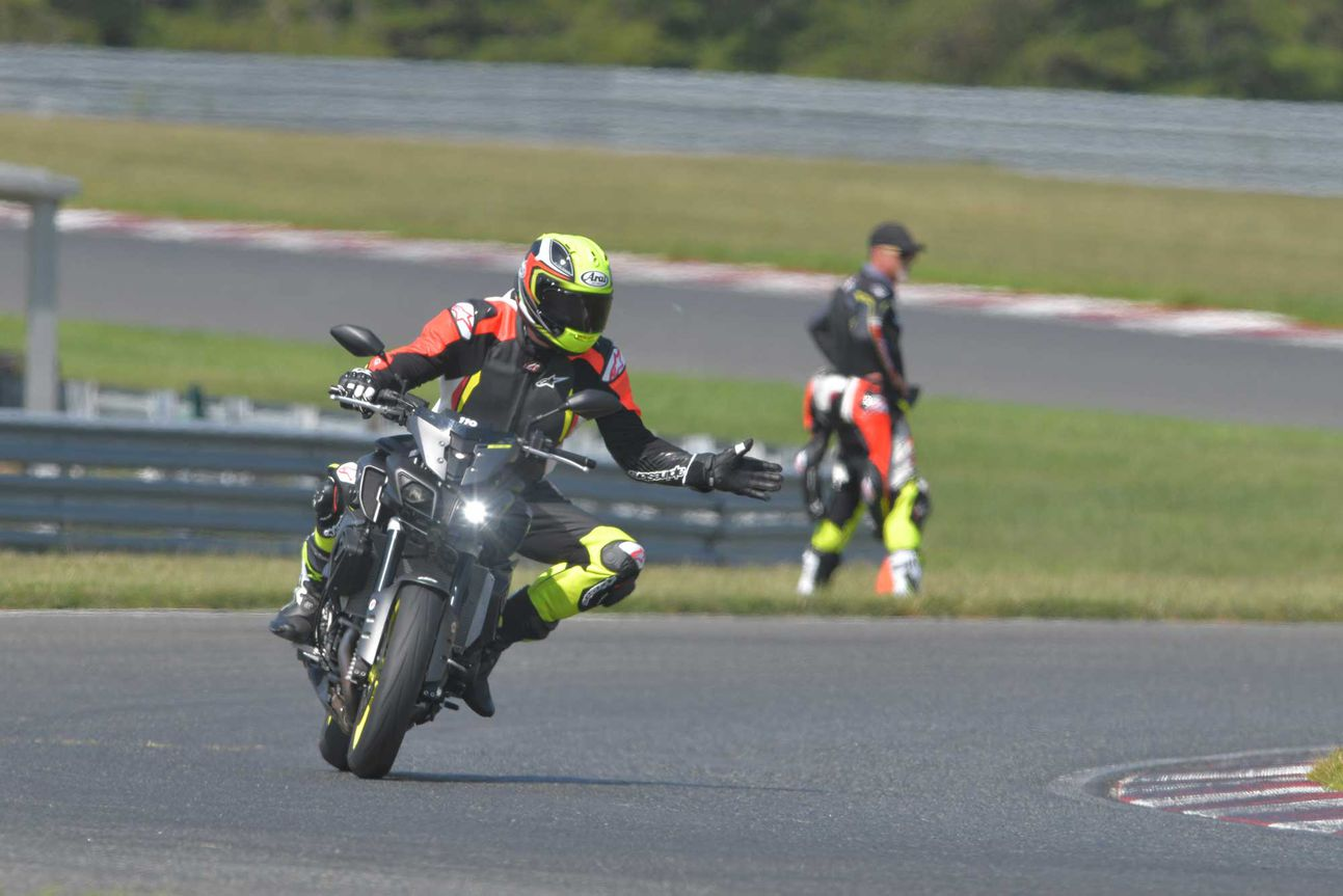 On-track motorcycle sign language.