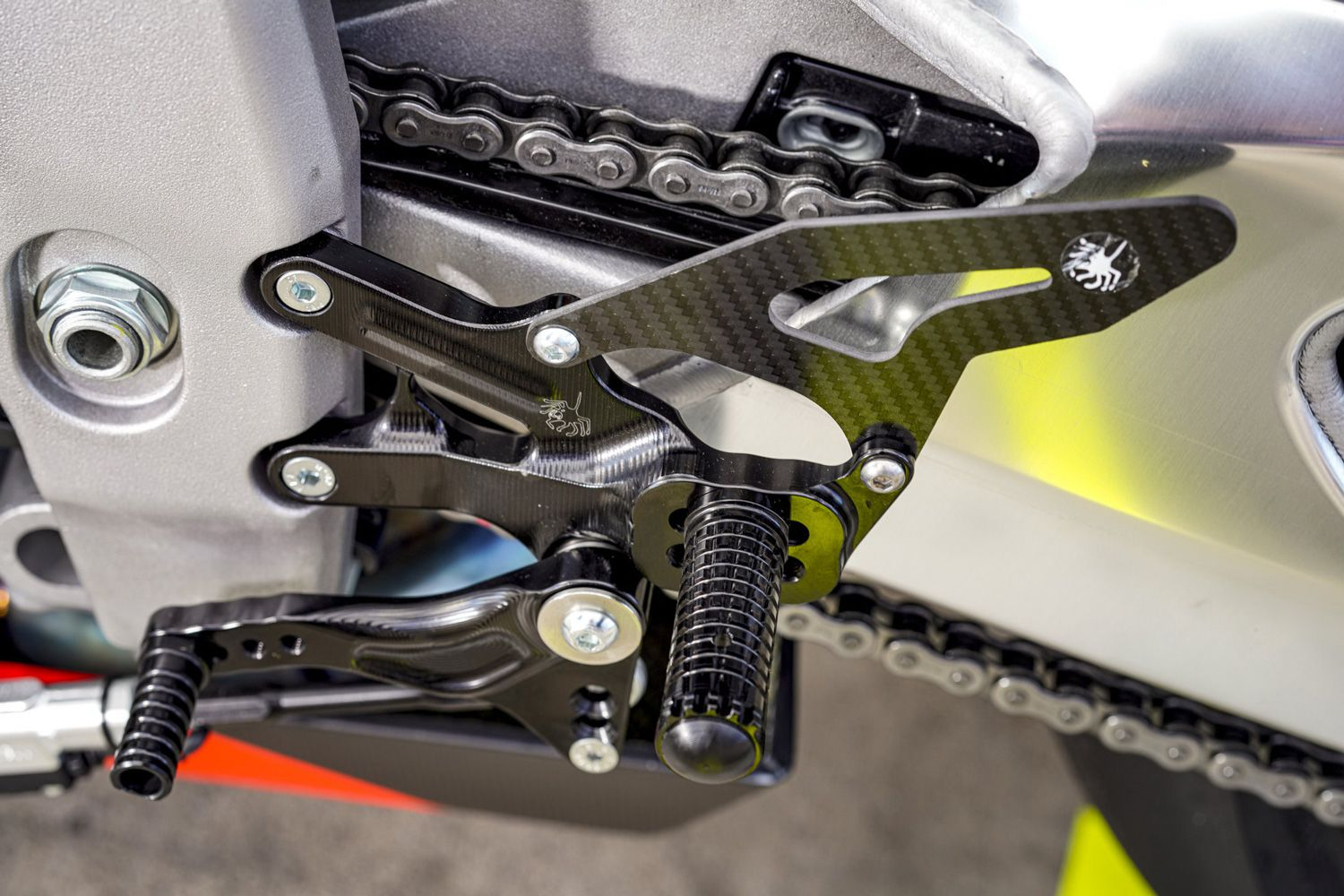 Up/down quickshifter enables clutchless shifts. Note adjustable footpegs.