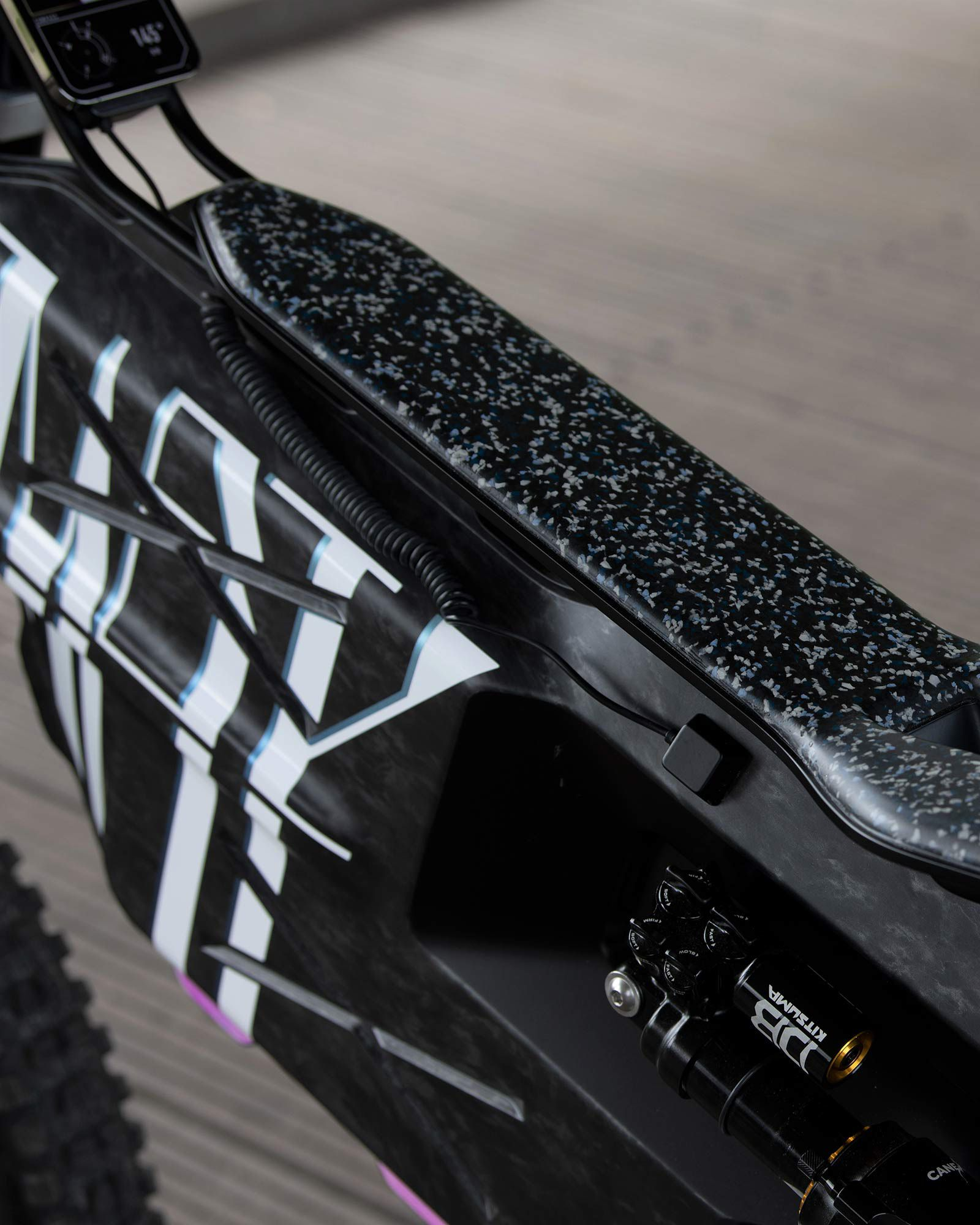 The flat seat borrows its profile from the narrow pads often seen on dirt bikes. BMW says it's made from recycled plastic.