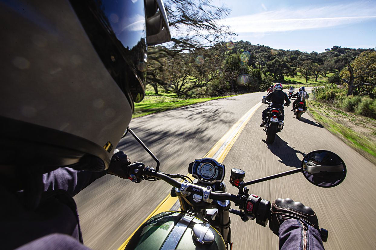 From the pilot's seat of the Triumph, an in-command big-dirt-bike riding position. So much spirit in all these bikes.