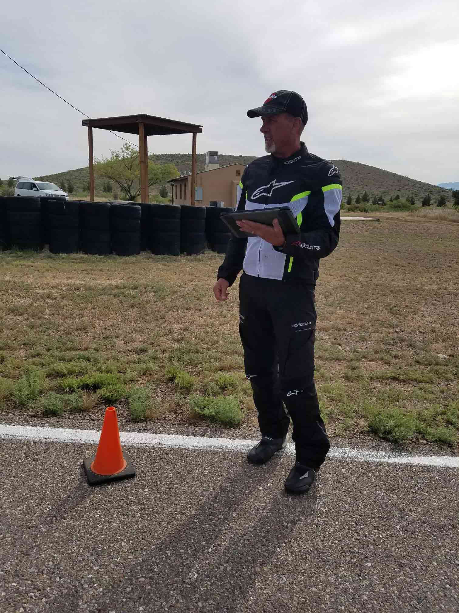 Mark Schellinger with his iPad practicing lines for the Pointy End drill in between Inde's turns 5 and 6.