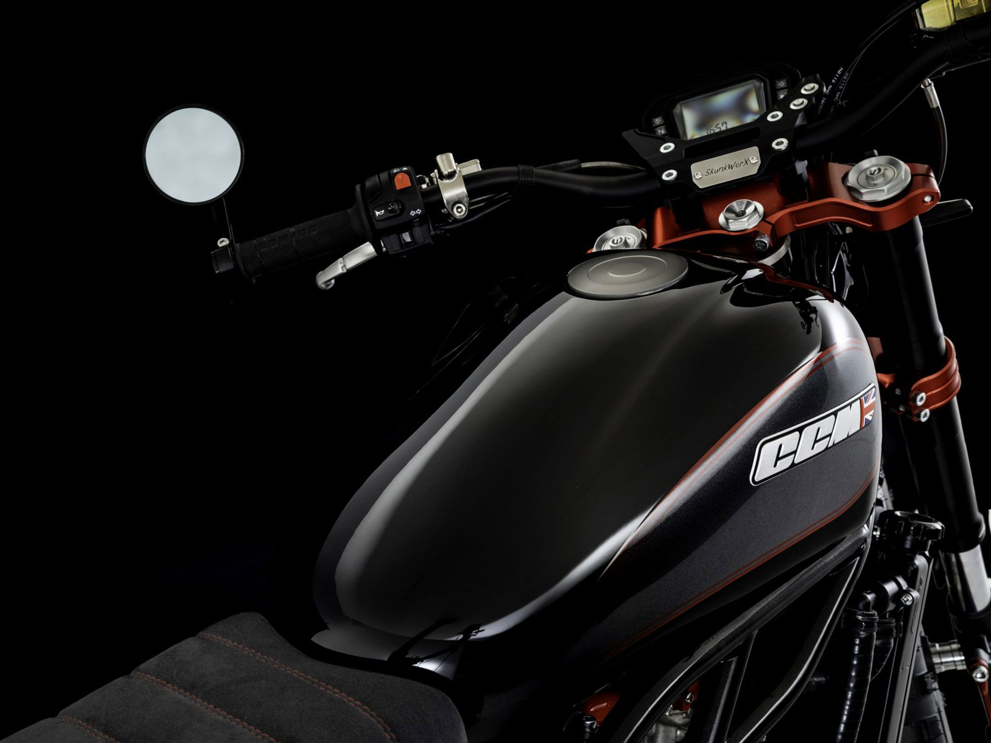 The cockpit features upswept bars and special Skunkwerx badging to denote the bike's provenance. The 3.6-gallon fuel tank keeps a similar profile to the original Scrambler version but takes on a unique black and gray paint job.