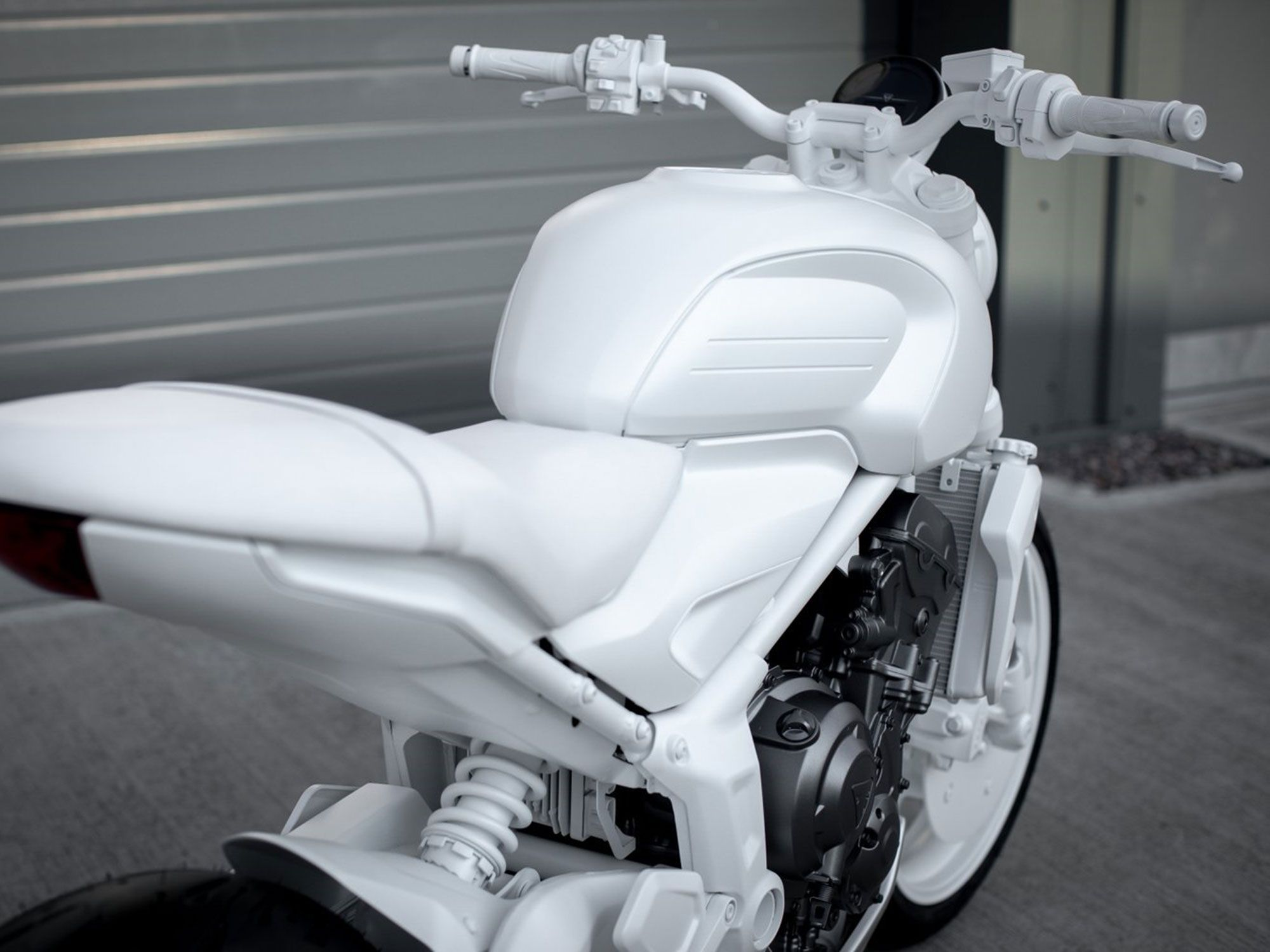 With a pillion portion reaching almost to the taillight, the new bike borrows elements from the '07 Street Triple, though the retro tank shape is a clear nod to the firm's past.