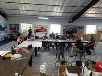 meeting at inde motorsports ranch garage with riders