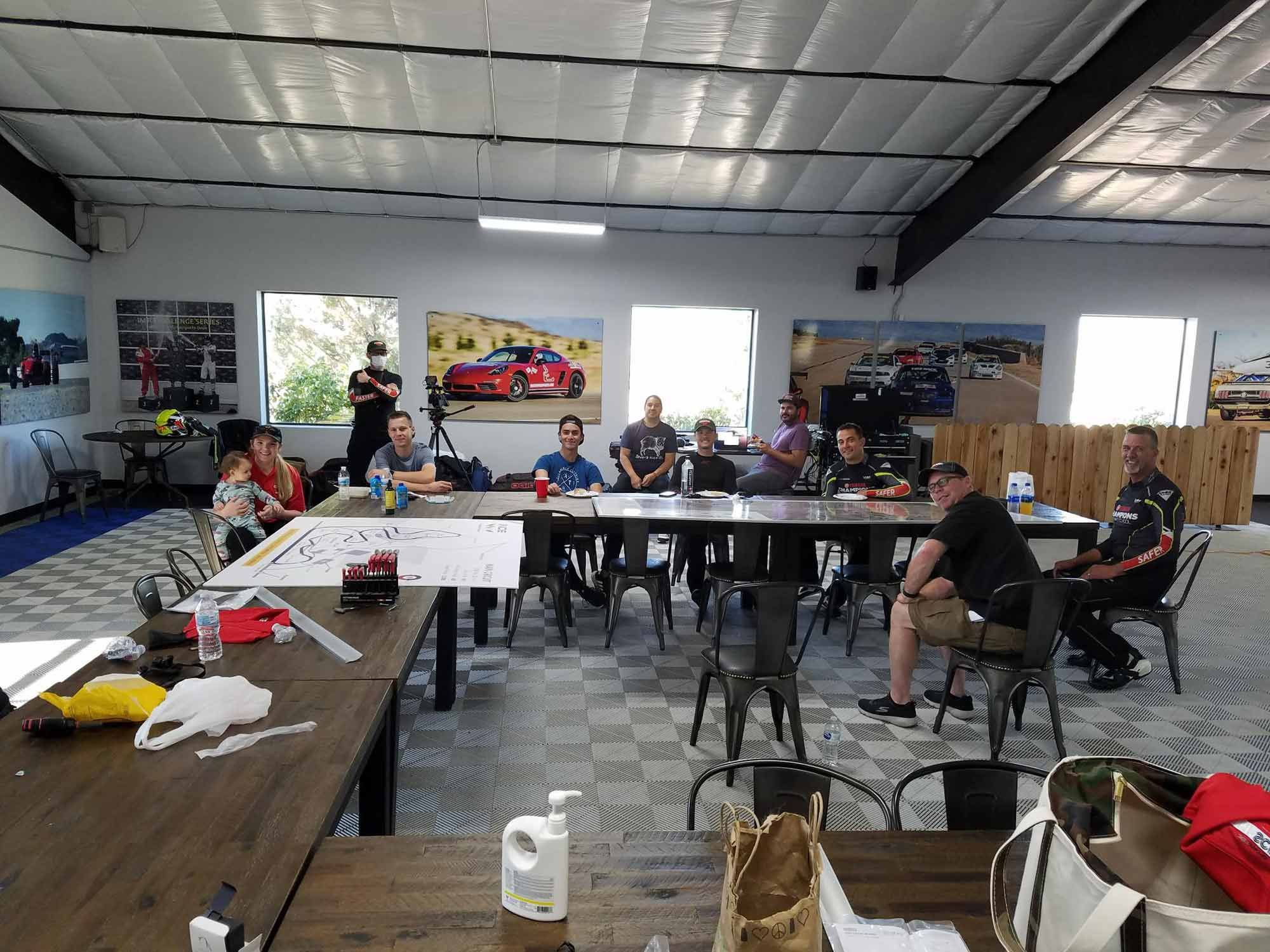 The gang assembles for the first time in Inde Motorsports Ranch's garage, including Elena Meyer's newly minted daughter (left). Five days later we would have a mountain of riding information…14 months later it would be ChampU.