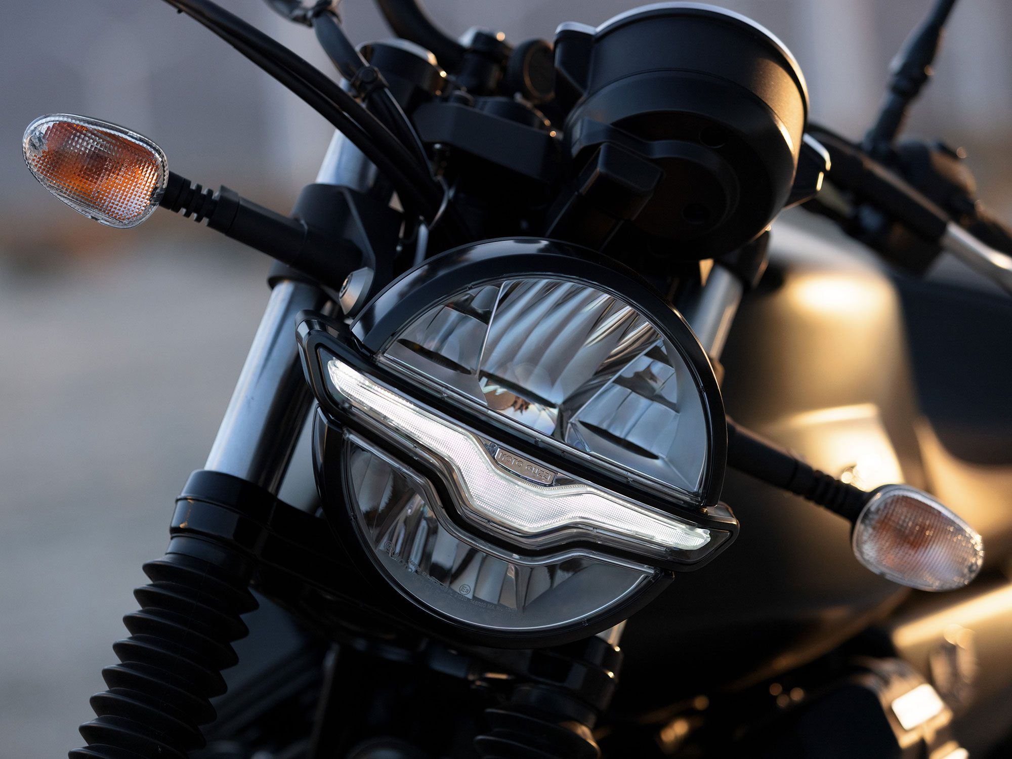 Subtle Moto Guzzi branding hides throughout the bike, like the eagle silhouette that serves as a daytime running light.