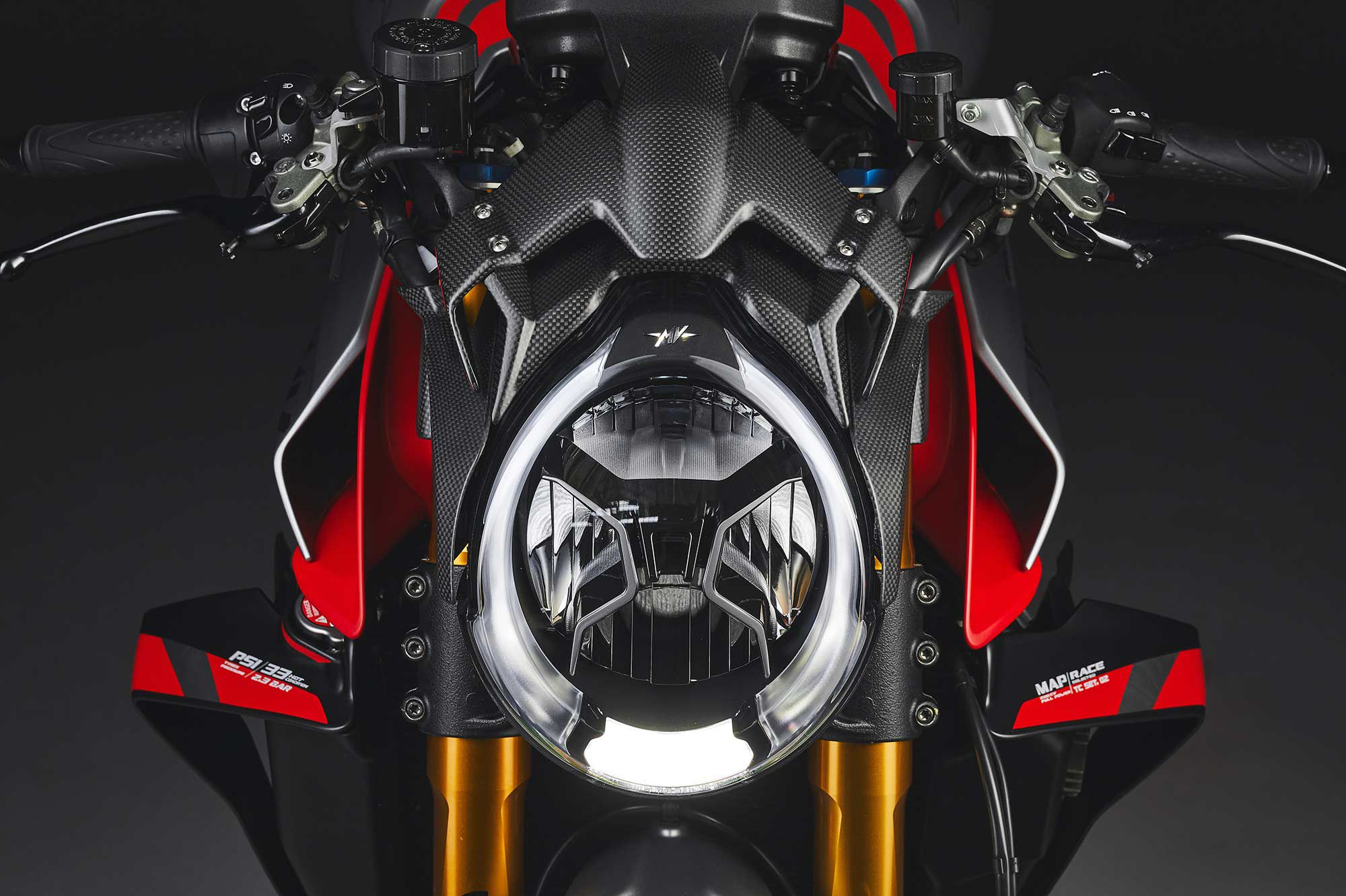 The subtle carbon fiber spoiler/cowl above and around the headlight is the only bodywork change to the new MV Agusta Brutale 1000 RR Nurburgring. While designed to increase downforce, it also sets the bike apart as a limited edition.