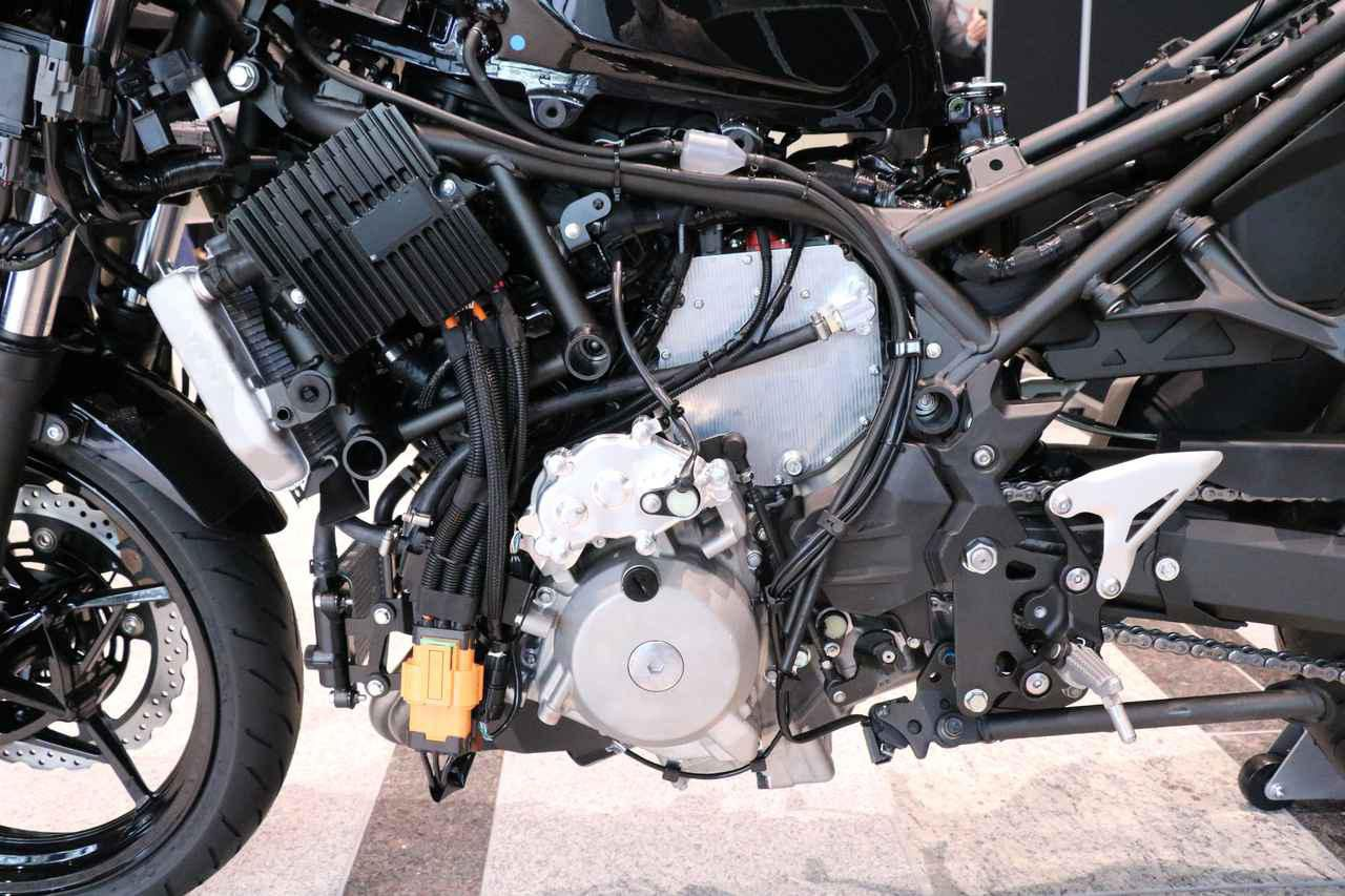 The prototype combines a parallel-twin engine and an electric motor above the transmission bolted to a purpose-built tubular steel frame.